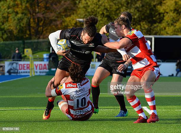 Mike Ellery of Saracens is tackled by Billy Burns of Gloucester Rugby during the Aviva Premiership match between Saracens and Gloucester Rugby at...