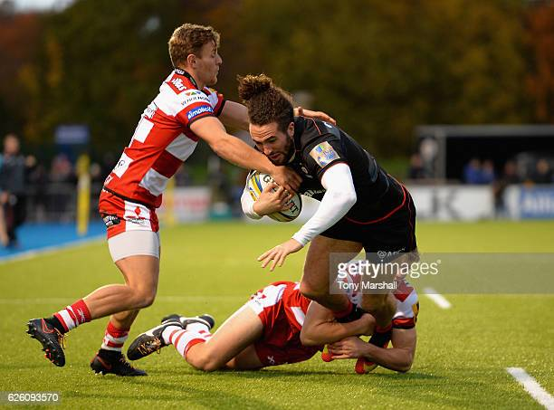 Mike Ellery of Saracens is tackled by Callum Braley and Ollie Thorley of Gloucester Rugby during the Aviva Premiership match between Saracens and...