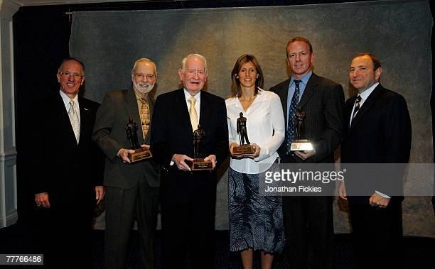 Mike Emrick poses with 2007 Lester Patrick Award recipients Stan Fischler John Halligan Cammi Granato Brian Leetch and NHL Commissioner Gary Bettman...
