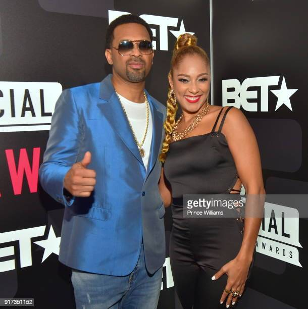 Mike Epps and Amanda Seales attend BET Social Awards Red Carpet at Tyler Perry Studio on February 11 2018 in Atlanta Georgia