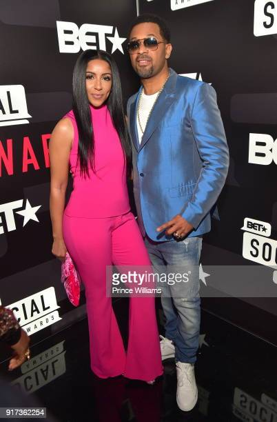 Mike Epps and Kyra Robinson attend BET Social Awards Red Carpet at Tyler Perry Studio on February 11 2018 in Atlanta Georgia