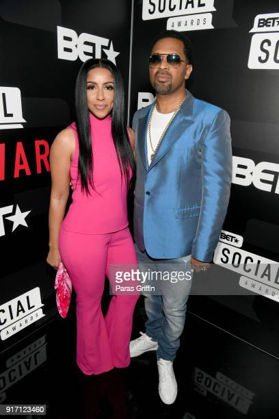 Mike Epps and Kyra Robinson attend BET's Social Awards 2018 at Tyler Perry Studio on February 11 2018 in Atlanta Georgia