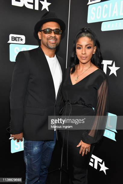 Mike Epps and Kyra Robinson attend the 2019 BET Social Awards at Tyler Perry Studio on March 3 2019 in Atlanta Georgia