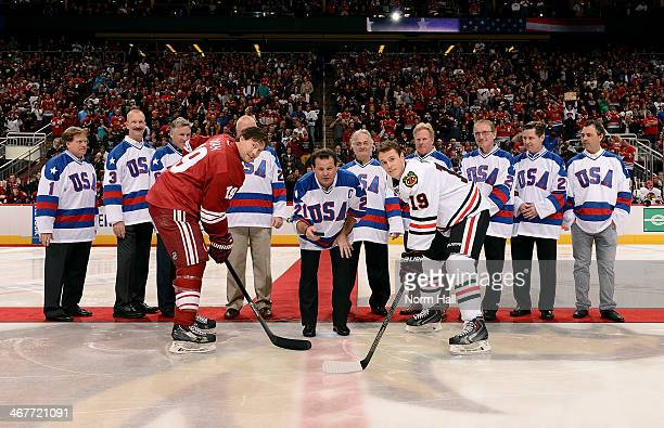 Mike Eruzione drops the puck between Shane Doan of the Phoenix Coyotes and Jonathan Toews of the Chicago Blackhawks as members of the 1980 USA...
