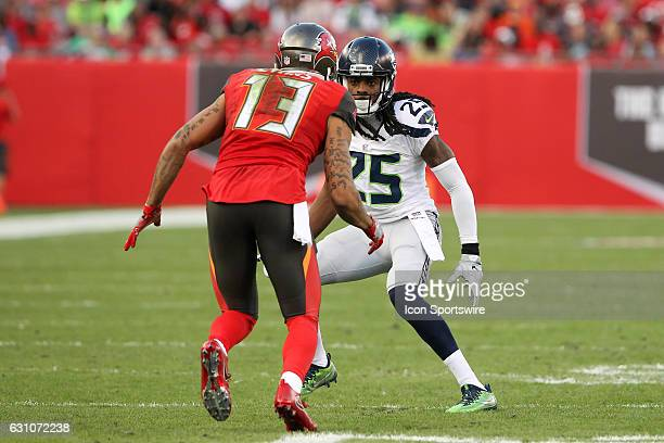 Mike Evans of the Buccaneers takes off from the line of scrimmage as Richard Sherman of the Seahawks never takes his eyes of Evans during the NFL...