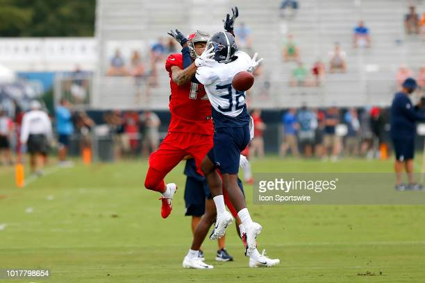 Mike Evans of the Bucs attempts to make a catch even though Kenneth Durden of the Titans has position on the play during the joint training camp work...