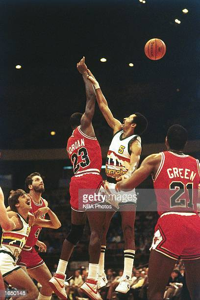 Mike Evans of the Denver Nuggets gets his shot blocked by Michael Jordan of the Chicago Bulls during the 1980 NBA game in Denver Colorado NOTE TO...