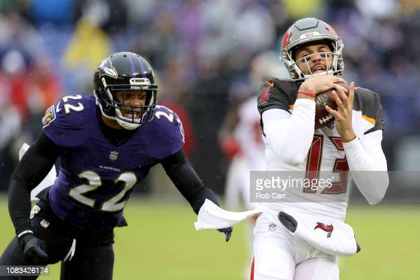 Mike Evans of the Tampa Bay Buccaneers catches a first half pass in front of Jimmy Smith of the Baltimore Ravens in the first half at M&T Bank...