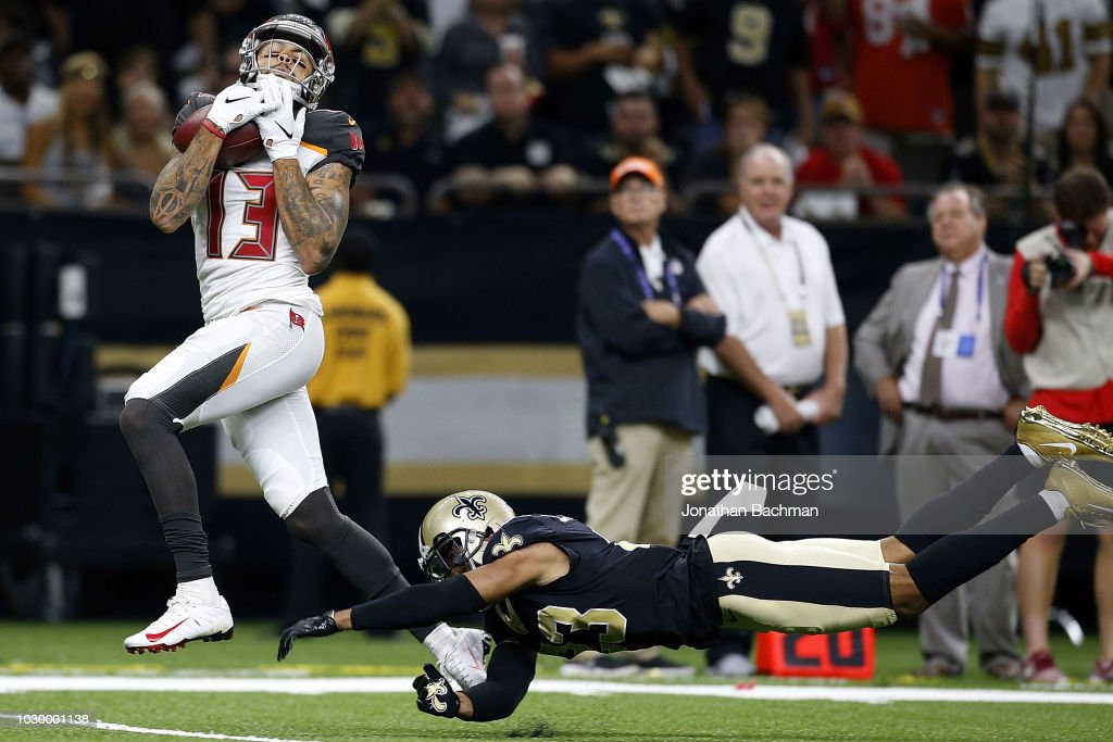 Mike Evans #13 of the Tampa Bay Buccaneers catches the ball for a touchdown as Marshon Lattimore #23 of the New Orleans Saints defends during the second half at the Mercedes-Benz Superdome on September 9, 2018 in New Orleans, Louisiana.
