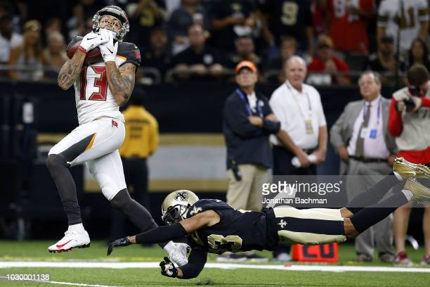 Mike Evans of the Tampa Bay Buccaneers catches the ball for a touchdown as Marshon Lattimore of the New Orleans Saints defends during the second half...