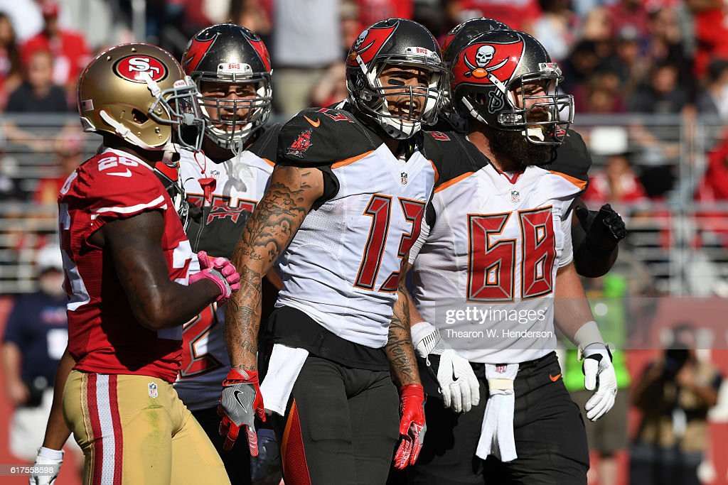 Mike Evans #13 of the Tampa Bay Buccaneers celebrates after a five-yard touchdown catch against the San Francisco 49ers during their NFL game at Levi's Stadium on October 23, 2016 in Santa Clara, California.