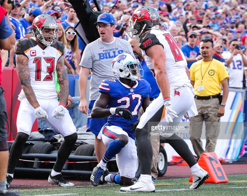 Mike Evans #13 of the Tampa Bay Buccaneers celebrates after scoring a touchdown with Cameron Brate #84 of the Tampa Bay Buccaneers during the fourth quarter of an NFL game against the Buffalo Bills on October 22, 2017 at New Era Field in Orchard Park, New York.