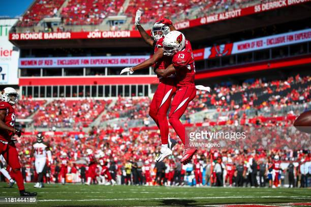 Mike Evans of the Tampa Bay Buccaneers celebrates with Breshad Perriman after a touchdown in the second quarter during the game against the Arizona...