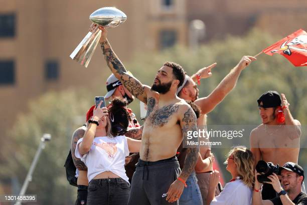 Mike Evans of the Tampa Bay Buccaneers celebrates with the Vince Lombardi Trophy during the Tampa Bay Buccaneers Super Bowl boat parade on February...