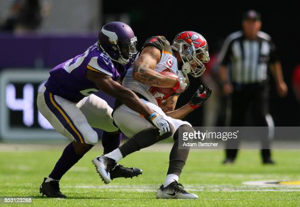 Mike Evans of the Tampa Bay Buccaneers is tackled with the ball by defender Xavier Rhodes of the Minnesota Vikings in the second of the game on...