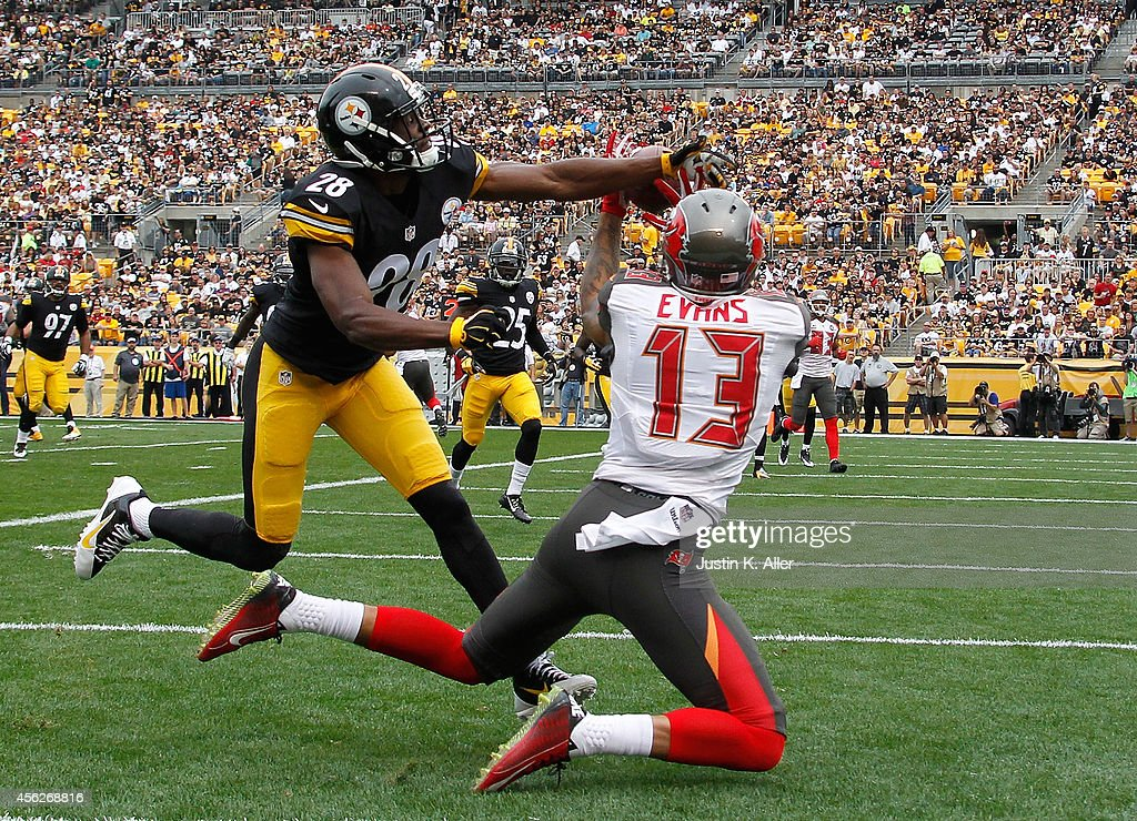 Mike Evans #13 of the Tampa Bay Buccaneers makes a touchdown catch in front of Cortez Allen #28 of the Pittsburgh Steelers during the first quarter at Heinz Field on September 28, 2014 in Pittsburgh, Pennsylvania.