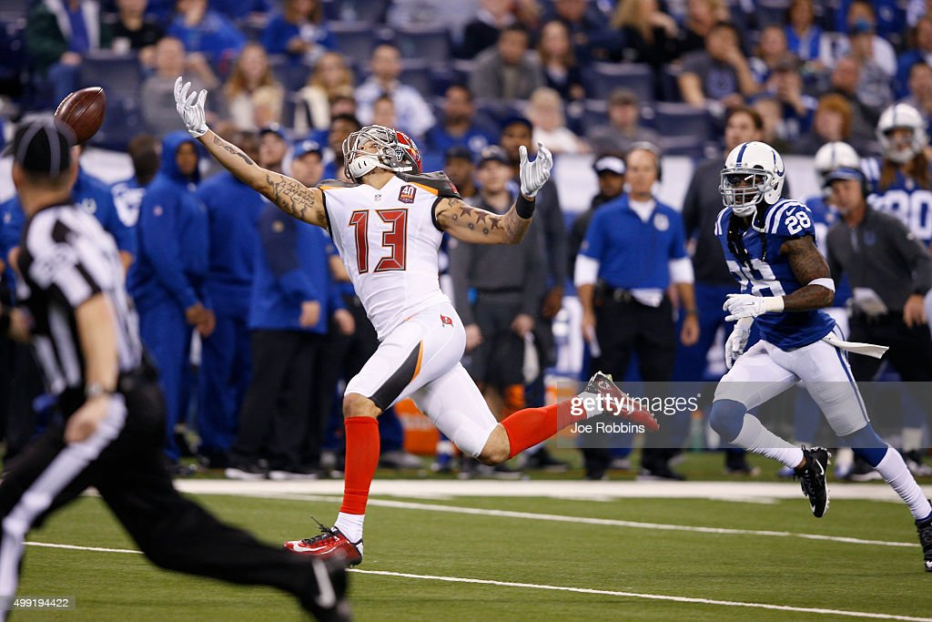 Mike Evans #13 of the Tampa Bay Buccaneers reaches but is not able to make a catch in the fourth quarter of the game against the Indianapolis Colts at Lucas Oil Stadium on November 29, 2015 in Indianapolis, Indiana. The Colts defeated the Bucs 25-12.