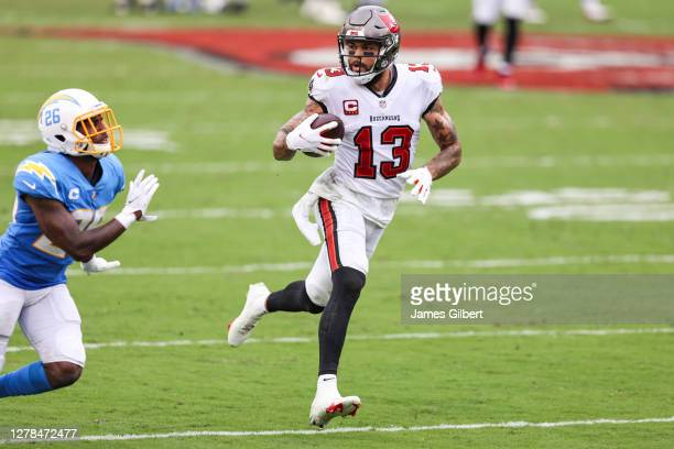 Mike Evans of the Tampa Bay Buccaneers runs for yardage after a catch against Casey Hayward of the Los Angeles Chargers during the fourth quarter of...