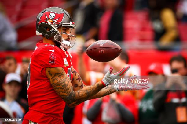 Mike Evans of the Tampa Bay Buccaneers warms up before the game against the New Orleans Saints on November 17 2019 at Raymond James Stadium in Tampa...