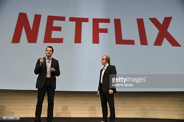 Mike Fasulo president and COO of Sony Electronics looks on as Reed Hastings chairman president and chief executive officer of Netflix Inc speaks...