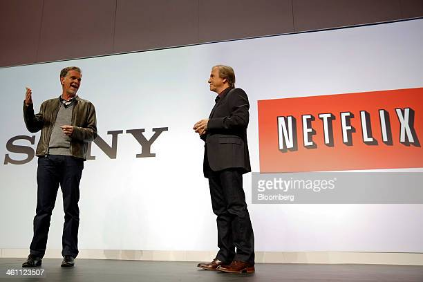 Mike Fasulo president of Sony Electronics Inc right looks on as Reed Hastings chairman president and chief executive officer of Netflix Inc speaks...