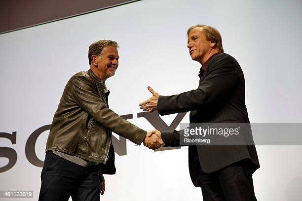 Mike Fasulo president of Sony Electronics Inc right shakes hands with Reed Hastings chairman president and chief executive officer of Netflix Inc...