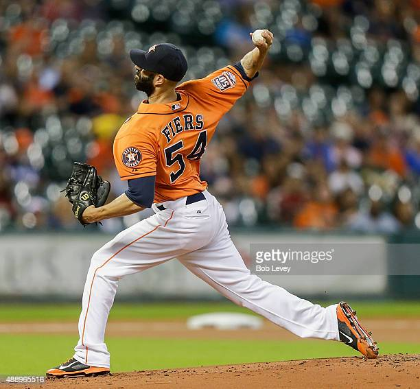 Mike Fiers of the Houston Astros throws in the first inning against the Oakland Athletics at Minute Maid Park on September 18 2015 in Houston Texas