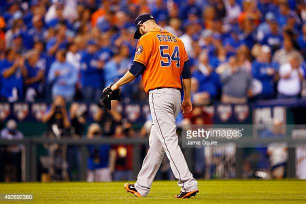 Mike Fiers of the Houston Astros walks off the field after the fifth inning against the Kansas City Royals during game five of the American League...