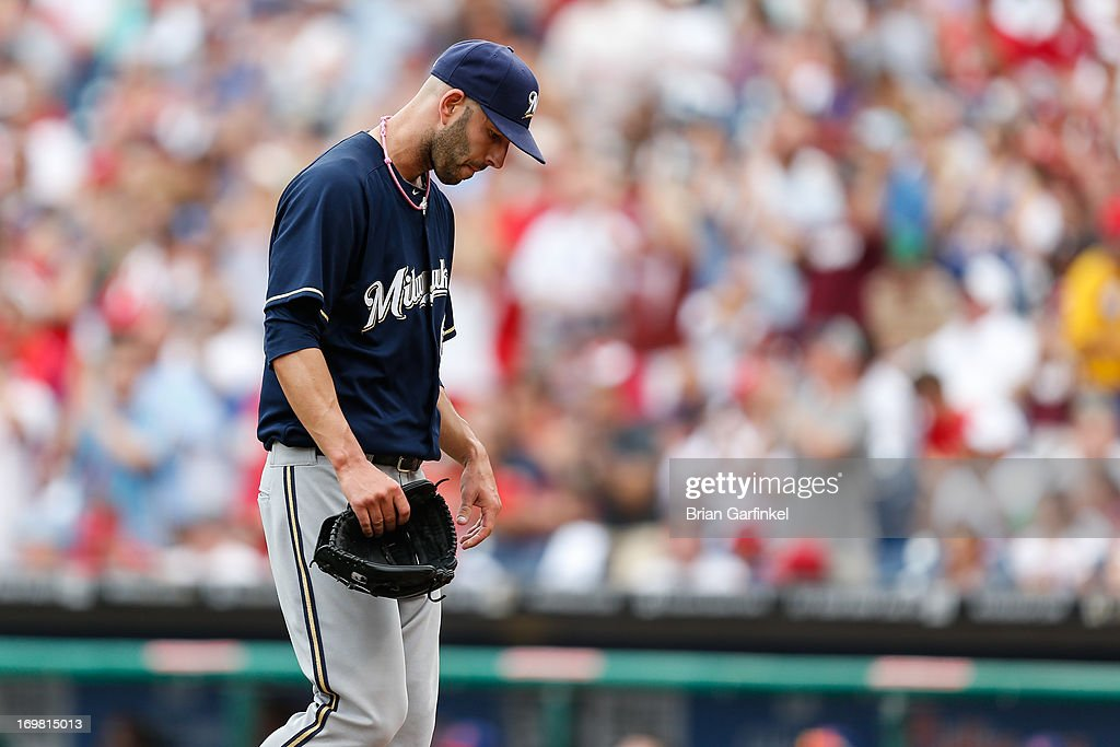 Mike Fiers #64 of the Milwaukee Brewers looks down as he walks back to the dugout after giving up five runs in the first inning of the game against the Philadelphia Phillies at Citizens Bank Park on June 2, 2013 in Philadelphia, Pennsylvania.