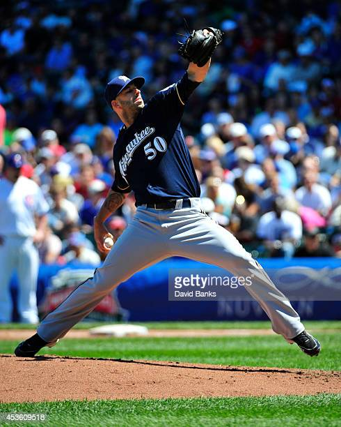 Mike Fiers of the Milwaukee Brewers pitches against the Chicago Cubs during the first inning on August 14 2014 at Wrigley Field in Chicago Illinois