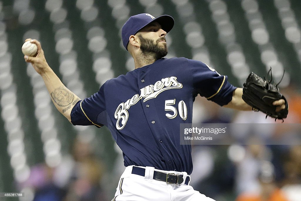 Mike Fiers #50 of the Milwaukee Brewers pitches during the first inning against the Miami Marlins at Miller Park on September 11, 2014 in Milwaukee, Wisconsin.