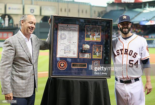 Mike Fiers receives from Houston Astros owner Jim Crane a shadowbox of momentos from his no hitter on August 21 2015 at Minute Maid Park on August 31...