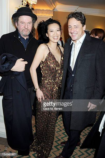 Mike Figgis Rosey Chan and Jeremy Healy attend Claridge's unveiling of the Alber Elbaz For Lanvin Christmas Tree at Claridge's Hotel on December 5...