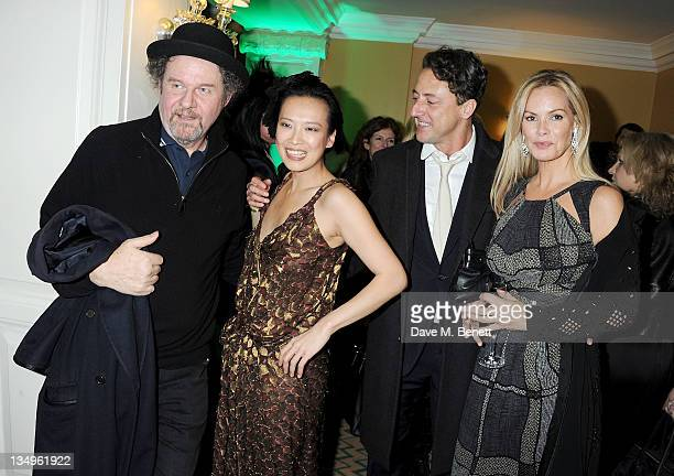 Mike Figgis Rosey Chan Jeremy Healy and Emma Woollard attend Claridge's unveiling of the Alber Elbaz For Lanvin Christmas Tree at Claridge's Hotel on...