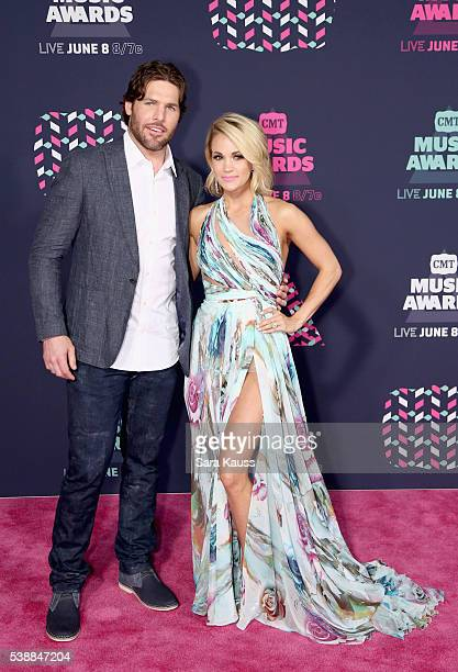 Mike Fisher and Carrie Underwood attend the 2016 CMT Music awards at the Bridgestone Arena on June 8 2016 in Nashville Tennessee