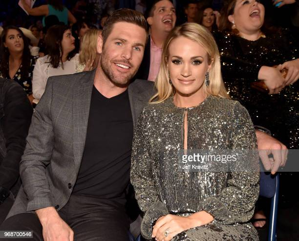 Mike Fisher and Carrie Underwood attend the 2018 CMT Music Awards at Bridgestone Arena on June 6 2018 in Nashville Tennessee