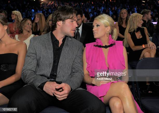 Mike Fisher and Carrie Underwood attends the 2010 CMT Music Awards at the Bridgestone Arena on June 9 2010 in Nashville Tennessee