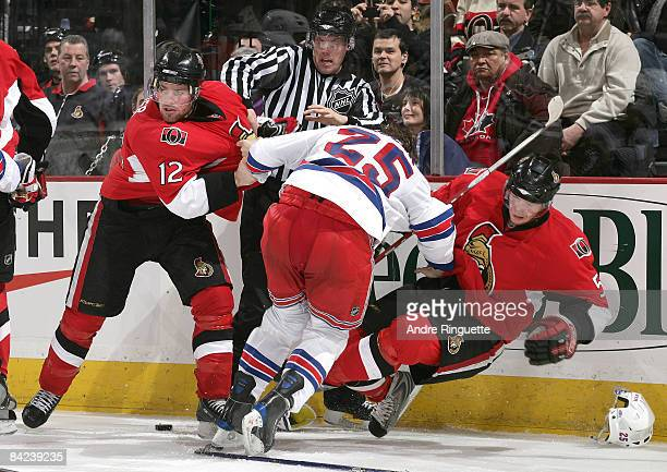 Mike Fisher and Christoph Schubert of the Ottawa Senators get into a tussle with Petr Prucha of the New York Rangers at Scotiabank Place on January...