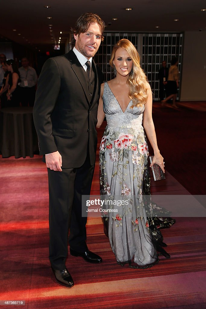 Mike Fisher (L) and Honoree Carrie Underwood attend the TIME 100 Gala, TIME's 100 most influential people in the world, at Jazz at Lincoln Center on April 29, 2014 in New York City.