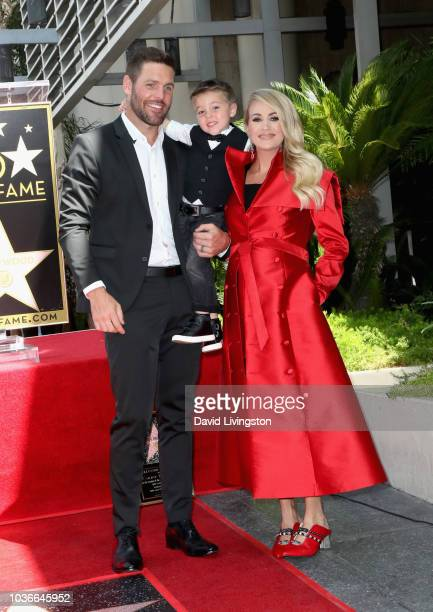 Mike Fisher and Isaiah Michael Fisher attend as Carrie Underwood is honored with a star on The Hollywood Walk of Fame on September 20 2018 in...