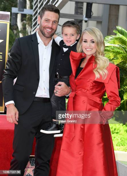 Mike Fisher and Isaiah Michael Fisher attend as Carrie Underwood Honored With Star On The Hollywood Walk Of Fameon September 20 2018 in Hollywood...
