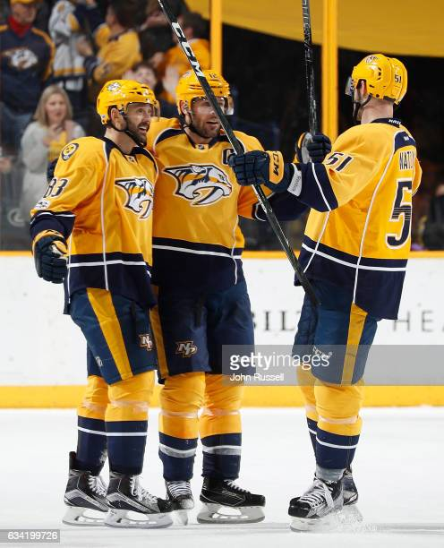 Mike Fisher celebrates his empty net goal with Vernon Fiddler and Austin Watson of the Nashville Predators against the Vancouver Canucks during an...