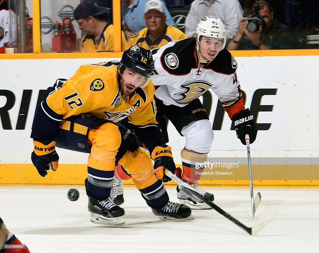 Mike Fisher #12 of the Nashville Predators and Sami Vatanen #45 of the Anaheim Ducks watch a bouncing puck during the third period in Game Six of the Western Conference First Round during the 2016 NHL Stanley Cup Playoffs at Bridgestone Arena on April 25, 2016 in Nashville, Tennessee.