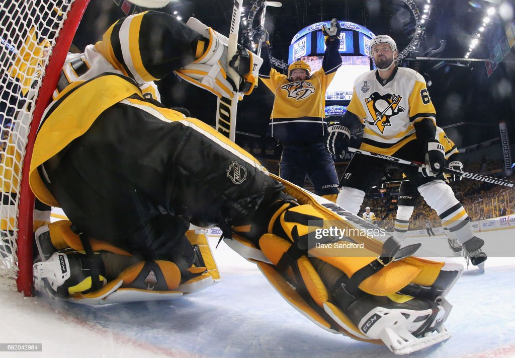 Mike Fisher #12 of the Nashville Predators celebrates a goal by teammate James Neal #18 (not pictured) as Ron Hainsey #65 of the Pittsburgh Penguins reacts during the second period of Game Three of the 2017 NHL Stanley Cup Final at Bridgestone Arena on June 3, 2017 in Nashville, Tennessee.