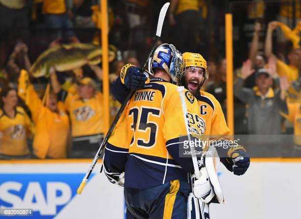 Mike Fisher of the Nashville Predators celebrates with goaltender Pekka Rinne after their team defeated the Pittsburgh Penguins 51 in Game Three of...