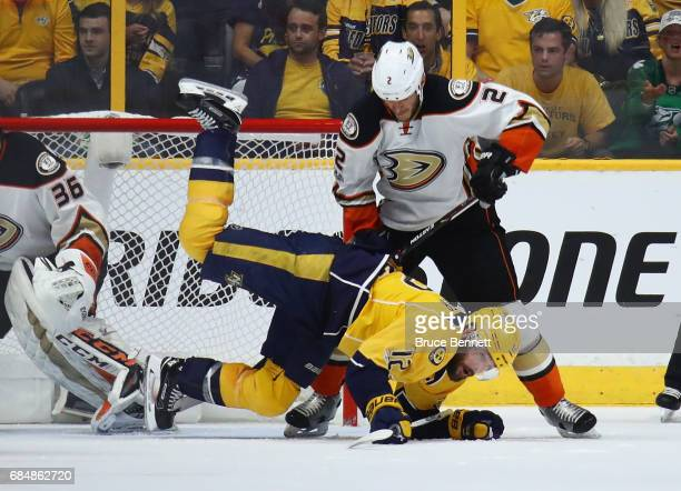 Mike Fisher of the Nashville Predators falls on the ice as Kevin Bieksa of the Anaheim Ducks looks on during the second period in Game Four of the...