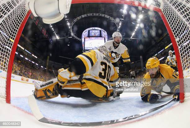 Mike Fisher of the Nashville Predators falls to the ice behind goaltender Matt Murray and Brian Dumoulin of the Pittsburgh Penguins during the second...