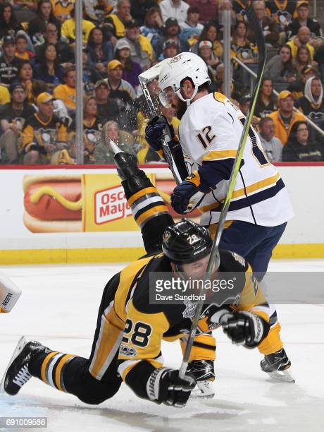 Mike Fisher of the Nashville Predators gets called for interference on Ian Cole of the Pittsburgh Penguins during the first period of Game Two of the...