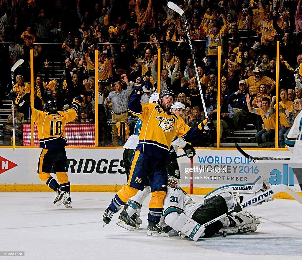 Mike Fisher #12 of the Nashville Predators reacts after teammate James Neal #18 scores the game tying goal against goalie Martin Jones #31 of the San Jose Sharks during the third period of Game Four of the Western Conference Second Round during the 2016 NHL Stanley Cup Playoffs at Bridgestone Arena on May 5, 2016 in Nashville, Tennessee.