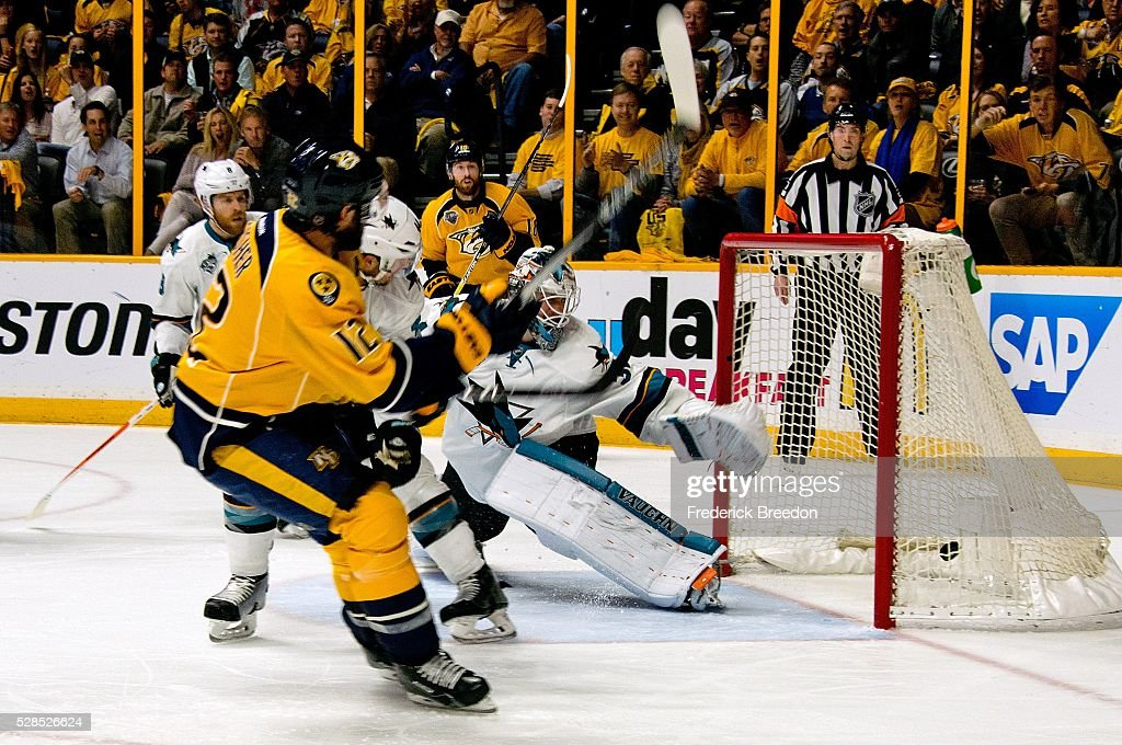 Mike Fisher #12 of the Nashville Predators scores a goal against goalie Martin Jones #31 of the San Jose Sharks during the first period of Game Four of the Western Conference Second Round during the 2016 NHL Stanley Cup Playoffs at Bridgestone Arena on May 5, 2016 in Nashville, Tennessee.